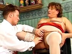 Guy fingering fat pussy of mature