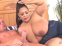 Chesty fat ebony woman sucks cock