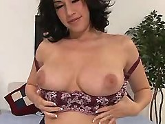 Brunette plumper presents her boobs
