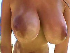 Redhead plays w big tits in nature