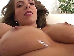 Sexual beauty caresses her big tits