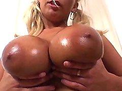 Breasty blonde babe sucks huge cock