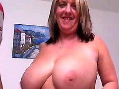 Horny chesty mature plays with cock