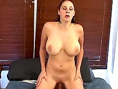 Chesty hottie rides big cock on bed