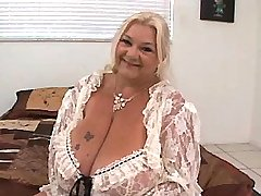 Fat mature woman shows huge boobs
