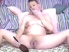 Pregnant blonde plays with pussy