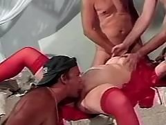 Pregnant woman in red sucking cocks