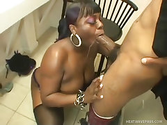 Busty black fatty takes a big black cock