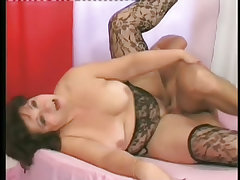 Older woman in stockings enjoying pussy